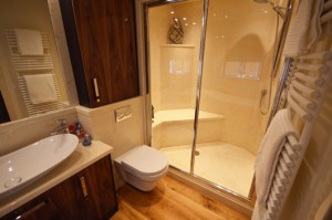 Large walk in shower with seat in cream onyx marble