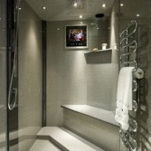 Modern grey granite wetroom bathroom designed and installed by Langley Interiors
