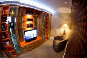 Walnut and orange high gloss media furniture with stoarge for CD's, DVD's and display areas.