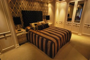 Elegant french style fitted bedroom in cream with rag rolled hand painted finish.