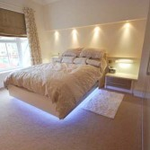 Cream fitted bedroom with wardrobes, bedside tables and spotlights/