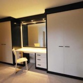 White high gloss bedroom wardrobes with black boarder and dressing table