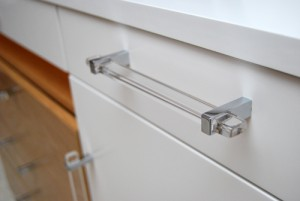 White drawer with clear handle and brushed silver features.