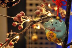 Blue porcelain money cat treet decoration.