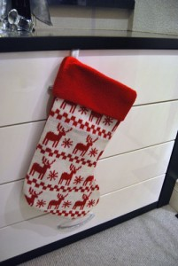 Red and white christmas stocking with reindeer.