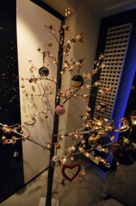 Lit blossom tree with otiental style christmas decorations.