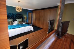 Black walnut fitted bedroom furniture.