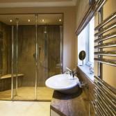 Cream and brown granite bathroom in Versital with screen divider.
