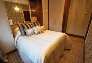 Luxury cream and black walnut fitted bedroom furniture.
