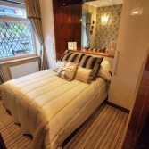 Fitted bedroom furniture in cream and black walnut high gloss