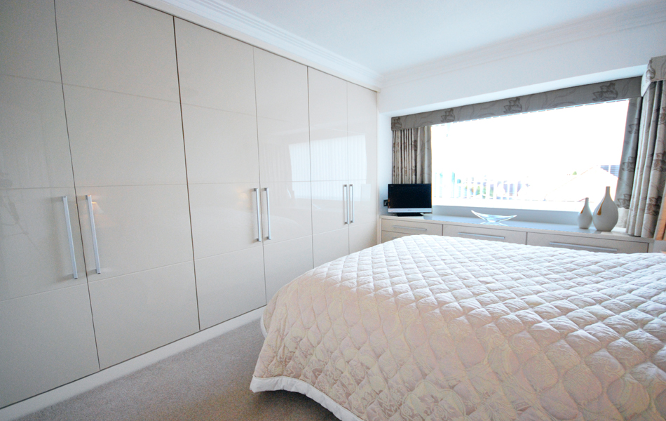 Simple cream high gloss bedroom
