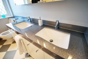 Twin sink vanity top in sparkle silver finish.