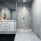 White marble shower with white bathroom cabinet and vanity top