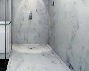 Carrara style shower with marble shower tray and marble panels.