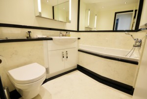 Black and white luxury bathroom with shaped bath