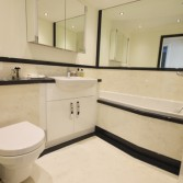 Black and white bathroom design using marble and granite finishes from Versital