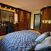 Bespoke fitted bedroom furniture in black walnut real wood veneers