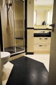 Black and white bathroom with custom floor slab pathway
