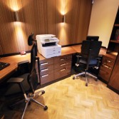 Home office in real wood veneers in black walnut with 2 work stations.