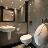Luxury bathroom in Just Silver sparkle - mirrors keep the bathroom feeling bright.