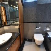 Silver and black sparkle luxury designer bathroom with walnut cabinet