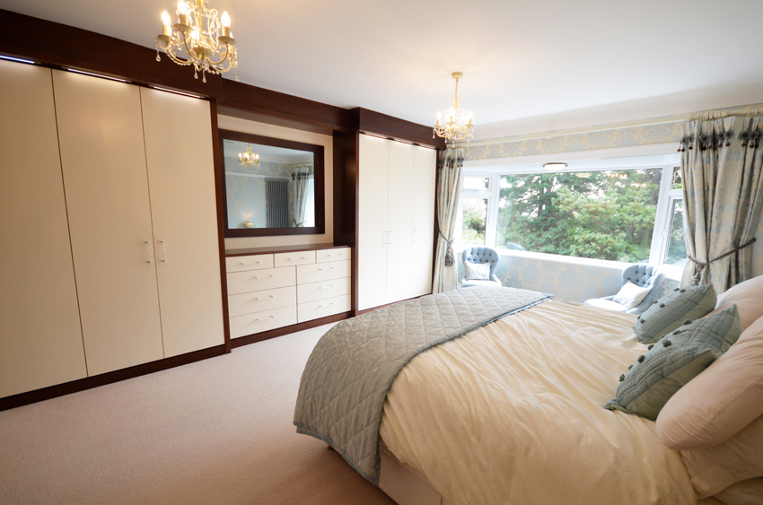 Bespoke fitted bedroom furniture in black walnut and cream