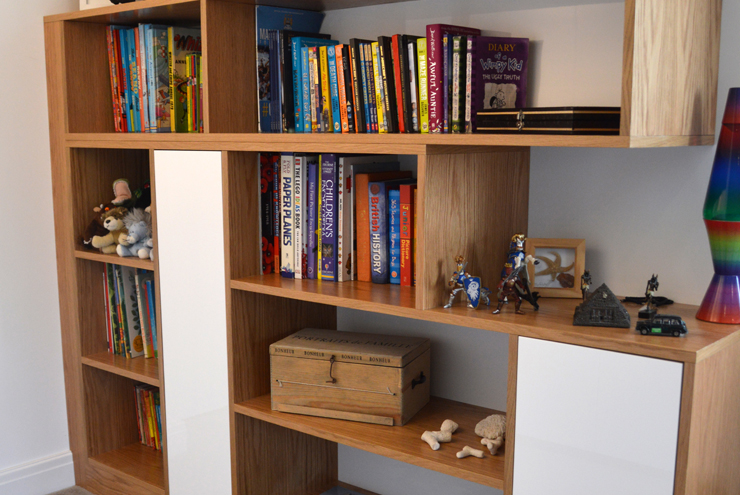 Modern toy storage made out of real oak wood with painted details