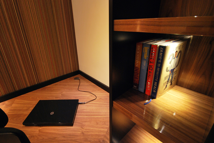 Laptop plug mounted into the corner of the desk and shelving unit in real wood