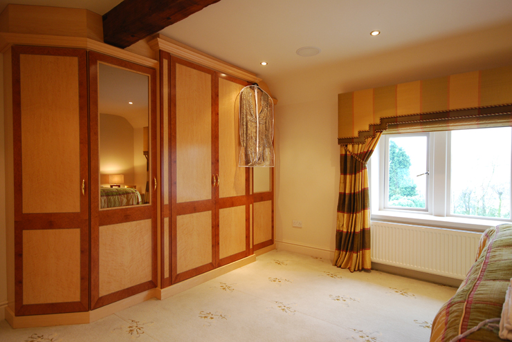 Hand crafted real wood veneers for beautifully detailed walk in wardrobes