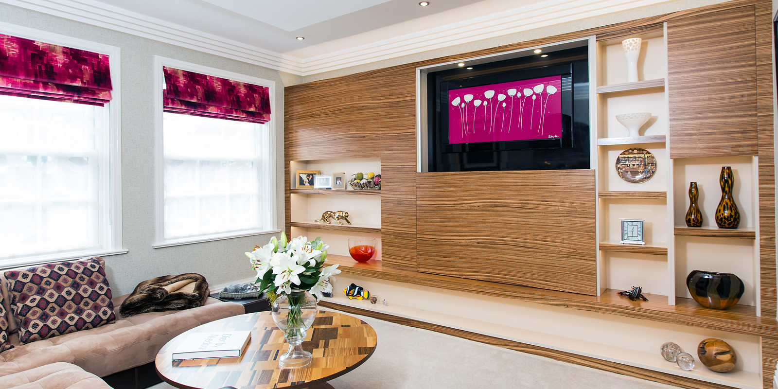 Full wall media unit in zebrano wood with a built in display shelves