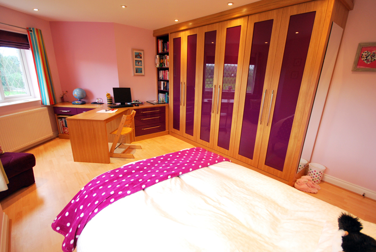 Bespoke kids bedroom furniture in purple high gloss and cherry wood with a matching desk