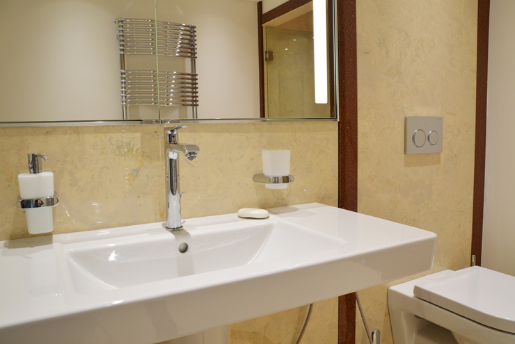 Large villeroy and boch sink and toilet with hansgrohe tap in En-suite bathroom