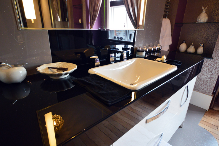 Master bathroom villeroy and boch sink with hansgrohe taps on high gloss black worktop