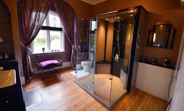 luxury fitted bathroom with glass shower enclosure