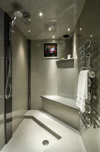 Grey granite wetroom shower with bespoke shower tray and panel