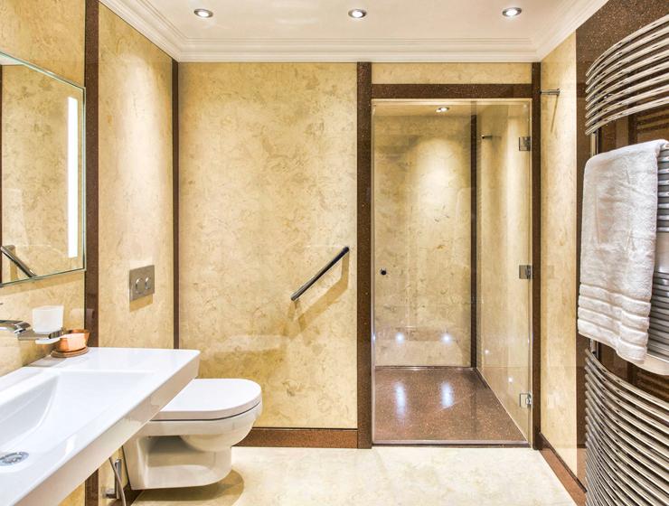 Versital wetroom style bathroom using bespoke shower tray and shower panels