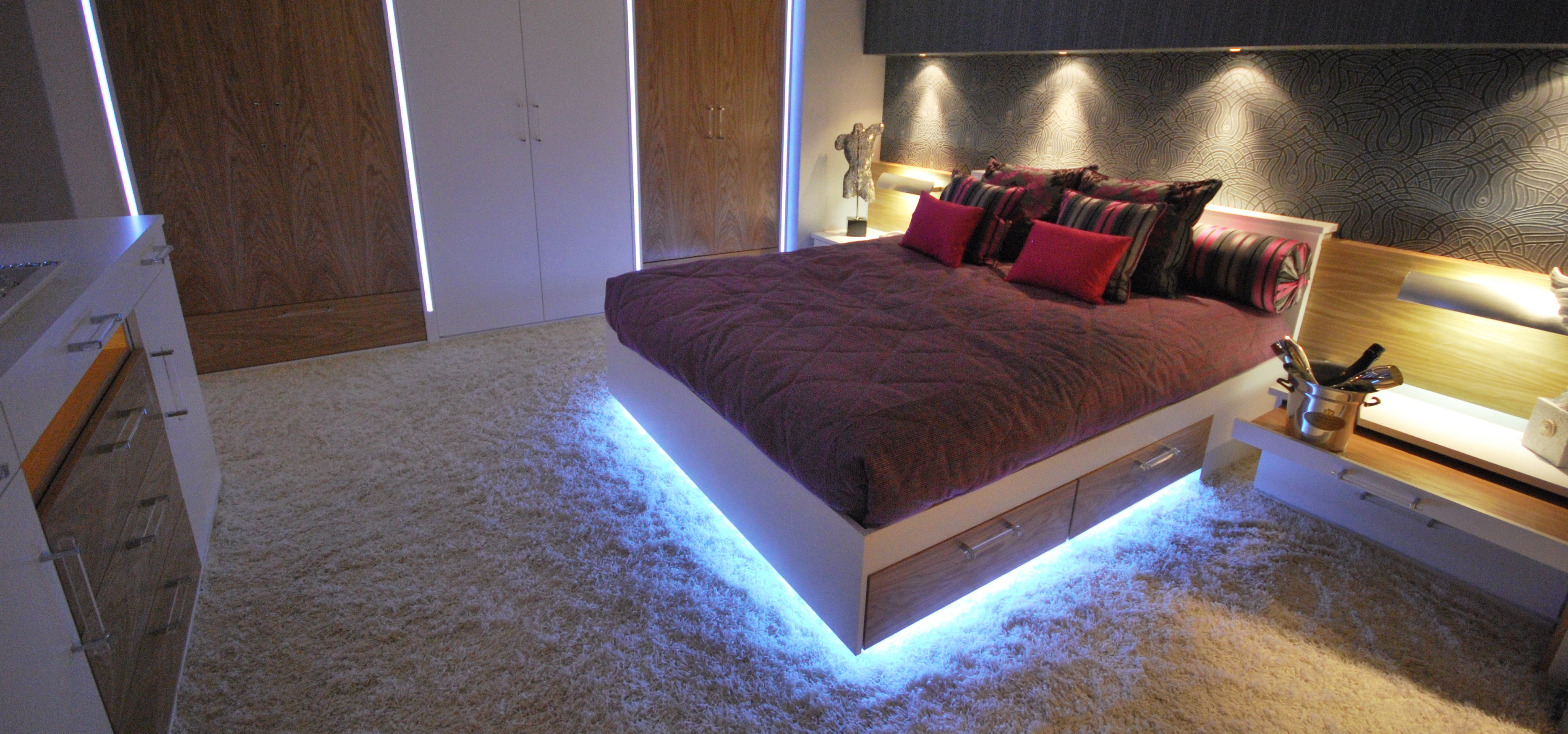 Light up bed with an overhead display and complimentary full wall wardrobe
