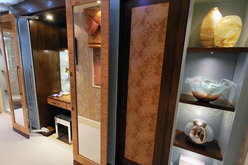 Storage solutions - walk in wardrobe in blue duck egg