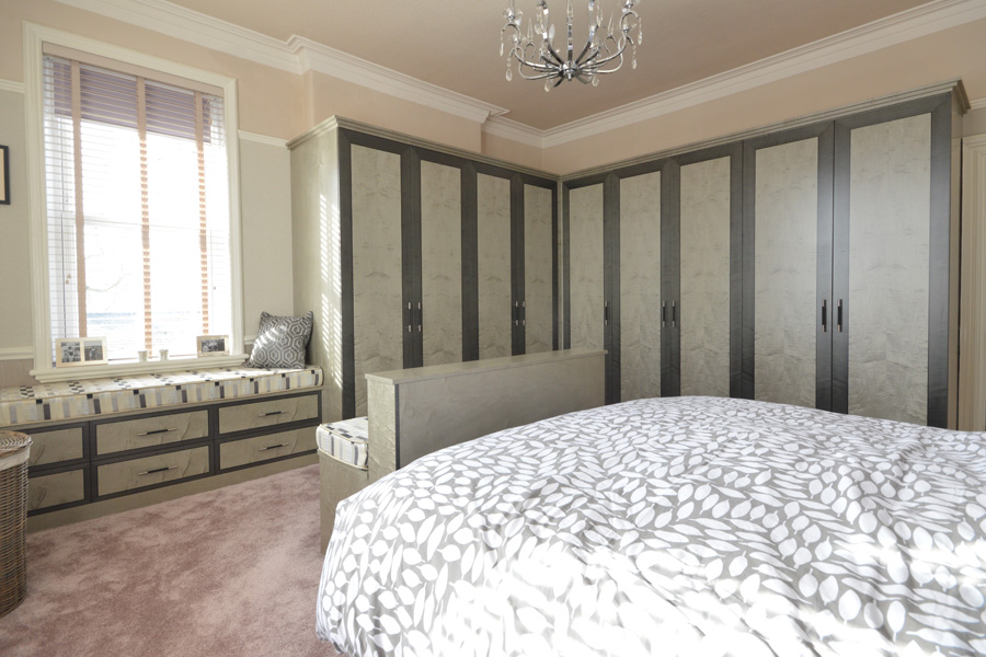 Bedroom wardrobe in sycamore wood and a sitting area