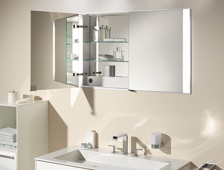 Keuco mirror cabinet with concealed storage, plug sockets and make-up lights