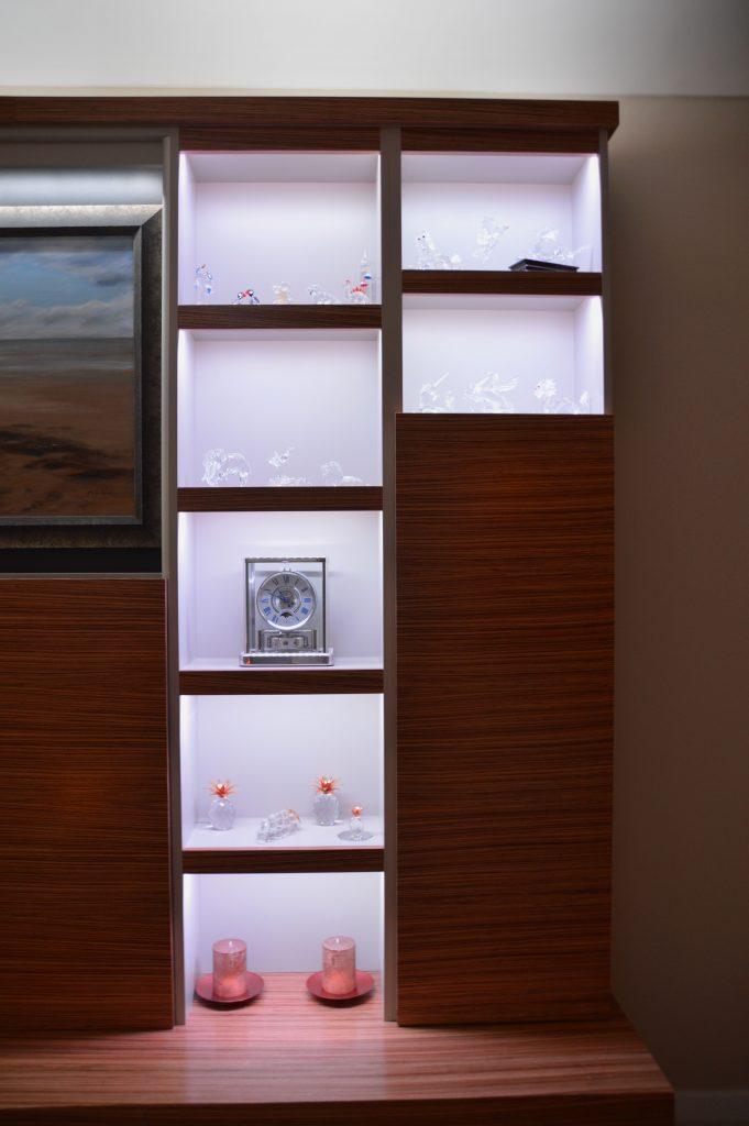 Shelves in the zebrano media unit