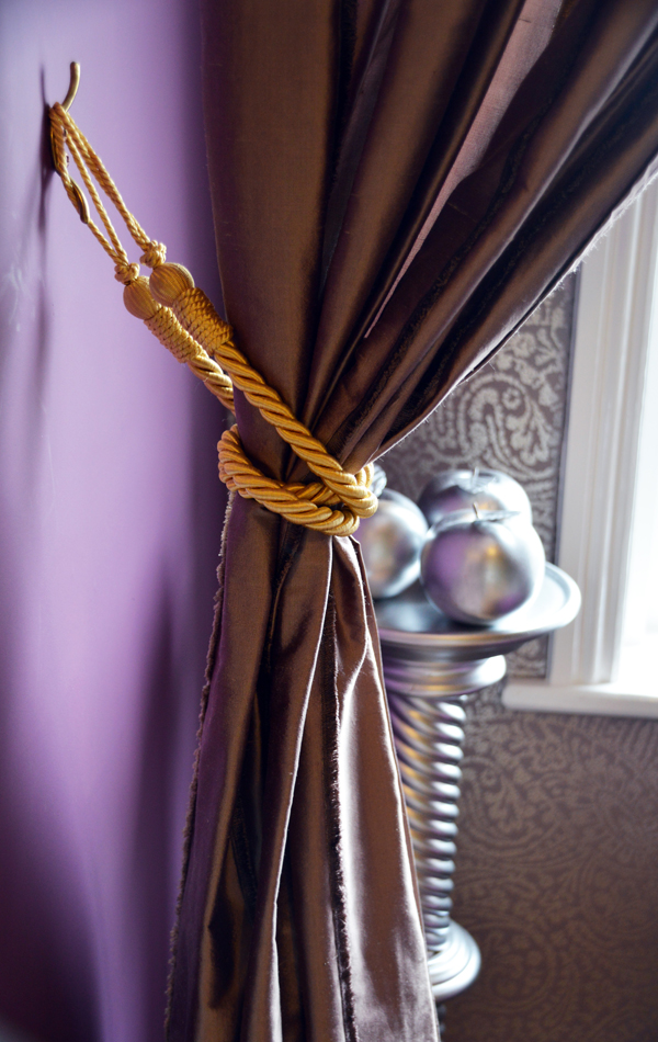 Beautiful curtain detail in silk royal purple with gold tie back