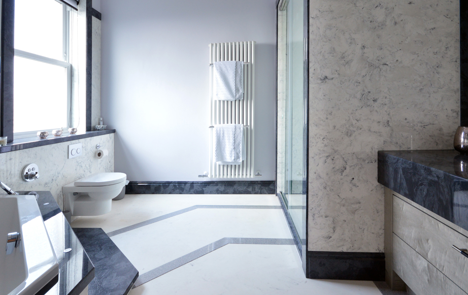 Stylish white marble bathroom design with contrasting grey elements all from versital