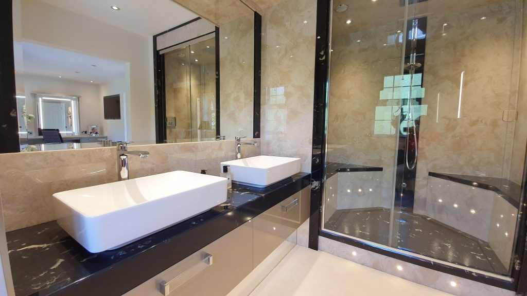 Large walk in shower with built in seats