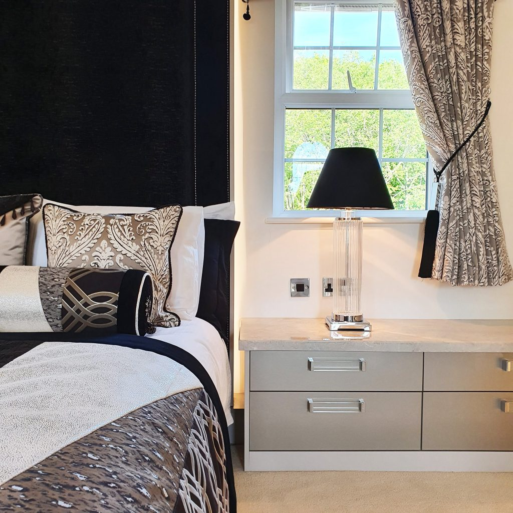 Luxury bedroom with fitted bespoke bedside drawers